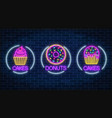 set of three neon glowing signs of donut and vector image