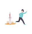young man running away from an exploding firework vector image vector image