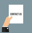 man showing paper contact us text vector image vector image