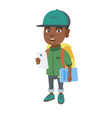 african schoolboy holding cellphone and textbook vector image