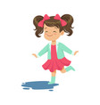 sweet little girl jumping and splashing through vector image vector image