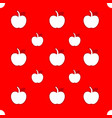white apple pattern on red background vector image