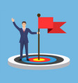 businessman with flag standing on a target vector image vector image
