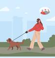 woman in medical mask walking a dog vector image vector image