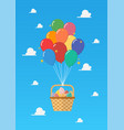 balloon with basket full easter eggs on blue vector image vector image