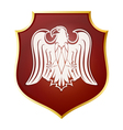 White silhouette of an eagle on a red shield vector image vector image