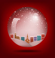 red christmas snow globe with a town inside vector image vector image