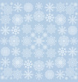 the pattern of snowflakes on a blue background vector image vector image