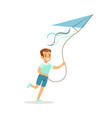 smiling boy playing with kite kids outdoor vector image vector image