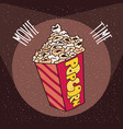 cardboard box with popcorn in beams spotlights vector image vector image