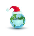 earth planet with medical mask and santa hat vector image