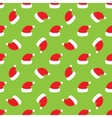 Red Santa hats on green background vector image vector image