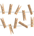 realistic detailed 3d wooden clothespins vector image
