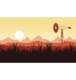 Silhouette of windmill on the farm scenery vector image vector image