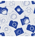 Seamless background with blue cameras vector image