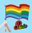 pride hand hold rainbow flag blue background vector image vector image