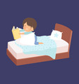 cute little boy reading a bedtime story in bed