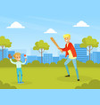 father playing baseball with his son in city park vector image vector image