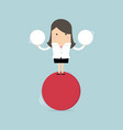 businesswoman balancing on red ball holding sphere vector image
