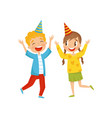 cute girl and boy in party hats having fun at vector image