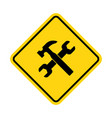 yellow under construction sign vector image vector image