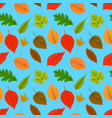 a seamless pattern of leaves and on a blue vector image vector image