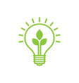 shining electric light bulb with green leaf vector image vector image