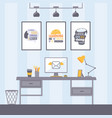 workplace with inspirational posters vector image