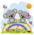 two koalas are sitting on the rainbow vector image vector image
