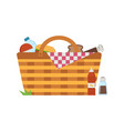 straw picnic basket with blanket vector image