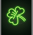 st patricks day neon sign and green brick wall vector image
