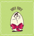 cracked egg with a red ribbon vector image vector image