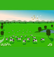 cows are eating grass in a green field vector image