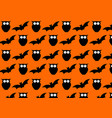 seamless halloween pattern on orange background vector image