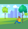woman sits on grass in city park and reading book vector image