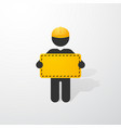 black figure with yellow helmet and a sign vector image vector image