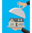 Hand opens serve cloche with house inside vector image vector image