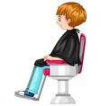 little boy sits on barber chair vector image vector image