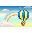 A hot air balloon near the rainbow vector image vector image