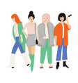 four young women in autumn clothes standing vector image