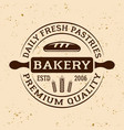 bakery vintage emblem with rolling pin vector image vector image