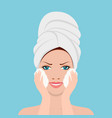 beautiful woman in process of washing face in vector image