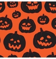 Seamless Halloween pattern with black pumpkins vector image