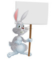white easter bunny holding sign vector image vector image