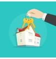 Home keys near house real estate concept vector image