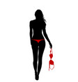 back view of young woman holding her red bra vector image