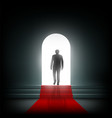 man goes to the light on the red carpet vector image
