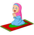 cartoon muslim girl praying on prayer rug vector image