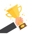 winner holding golden cup in hand vector image