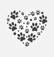 dark paw prints in heart shape vector image vector image
